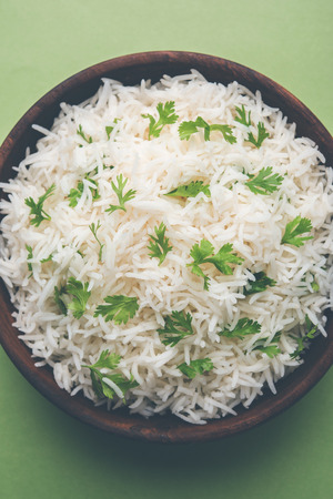 Coriander or cilantro Basmati Rice, served in a ceramic or terracotta bowl. It's a popular Indian OR Chinese recipe. Selective focus Stock Photo