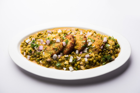 Ragda Pattice is a popular Street food or chat made of potato Patties. served in a steel plate, bowl or ceramic plate with tamarind and cilantro chutney