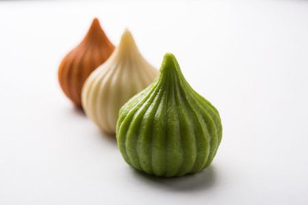 Sweet Tiranga coloured modak shape mithai or dumpling for Independence or republic day greeting card Stock Photo