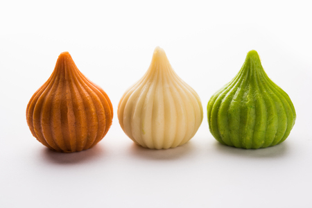 Sweet Tiranga coloured modak shape mithai or dumpling for Independence or republic day greeting card Banco de Imagens