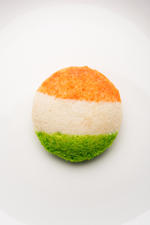 Tiranga Idly or Idli made using Indian National Flag colours like saffron, white and green. Served with colourful chutney. Concept for Happy Independence day greeting card Stock Photo