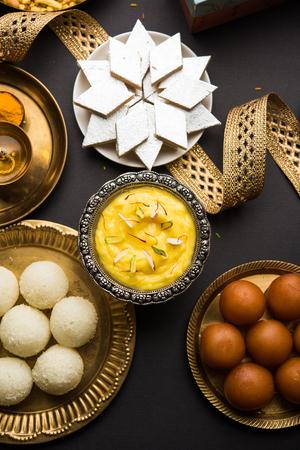 Raksha bandhan greetings : Sweet food like Gulab Jamun, Rasgulla, Shrikhand, Bundi Laddu, Kaju Katli and farsan with Pooja thali for Rakhi Festival Celebration