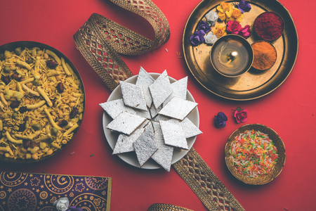 Raksha bandhan Festival greetings: conceptual Rakhi made using a plate full of Kaju Katli Barfi/Burfi and fancy band and pooja Thali. selective focus Stock Photo