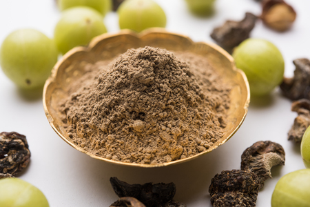 Amla powder with raw Avla, its an Ayurvedic alternative medicine