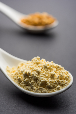 Besan, Gram or chickpea flour or powder is a pulse flour made from a variety of ground chickpea known as Bengal gram. popular ingredient for Pakora/pakoda or bajji snack. Selective focus