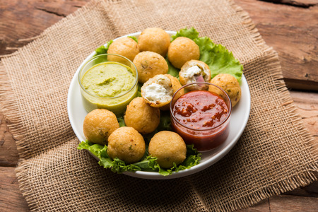Dahi Ke Angare also known as Kabab or kebab is a popular snack item from India / Pakistan. served with green and red sauce. Selective focus 스톡 콘텐츠