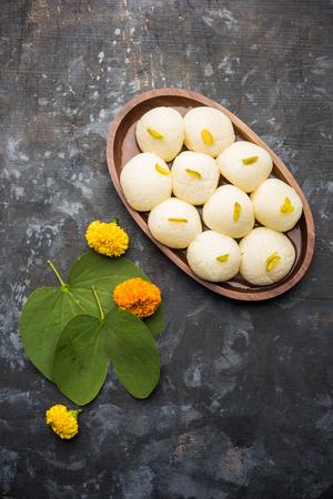 Happy Dussehra / Vijayadashami / Ayudh Puja greeting card using apta/Bauhinia racemosa/Bidi leaf and Indian sweet Rasgulla for Navaratri Stock Photo