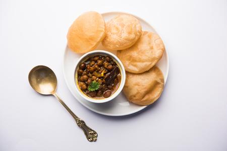 Chole puri or chana masala with fried poori Stock Photo