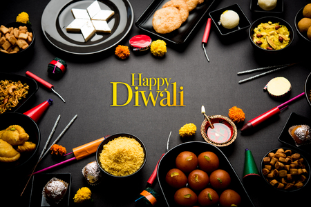 Happy Diwali Greeting Card made using sweets, or fire crackers or Diya or flowers