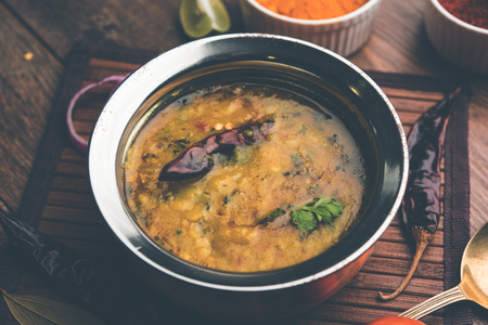 Dal Tadka Fry / Indian Lentil Curry served in a bowl with rice and roti, selective focus