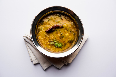 Dal Tadka Fry  Indian Lentil Curry served in a bowl with rice and roti, selective focus