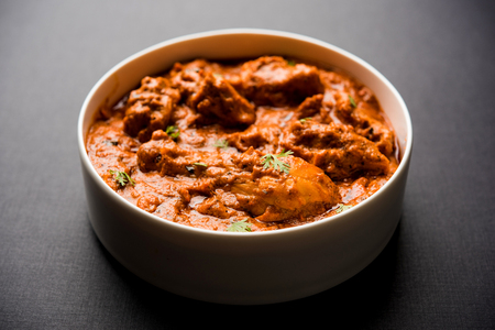 Murgh Makhani / Butter chicken tikka masala served with roti / Paratha and plain rice along with onion salad. selective focus Stock Photo