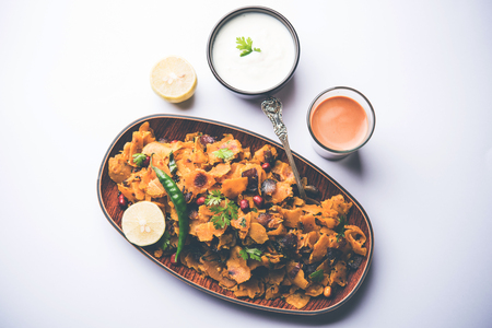 Homemade Kothu Parotta/ Paratha or Stir Fried Leftover Chapati Masala or  fodnichi poli in marathi, served in a bowl or plate with curd and hot tea. Selective focus