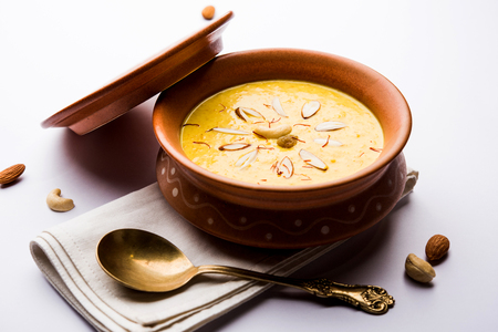 Kaddu or Pumpkin Kheer Or Bhoplyachi Kheer in Marathi and gummadikaya payasam in Telugu, Garnished with dry fruits. served in a bowl over moody background. Selective focus
