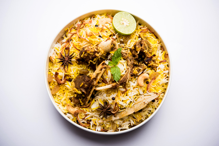 mutton or lamb biriyani with basmati rice, served in a bowl over moody background. 版權商用圖片
