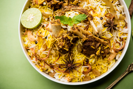 mutton or lamb biriyani with basmati rice, served in a bowl over moody background. Reklamní fotografie