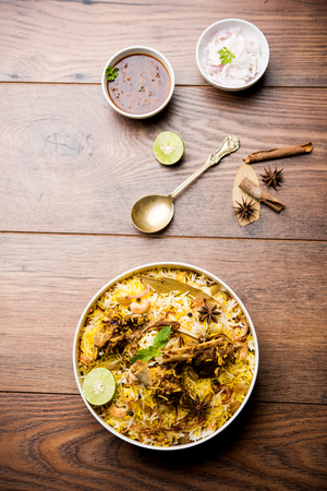 mutton or lamb biriyani with basmati rice, served in a bowl over moody background. Stock Photo