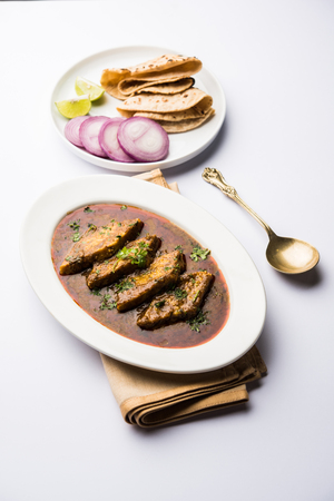 Patodi Rassa Bhaji or patwadi Sabji, a popular Maharashtrian spicy recipe served with Chapati and salad. Selective focus Banque d'images