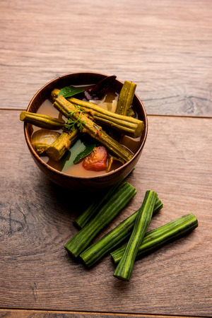 Drumstick Curry or Shevga sheng bhaji or south indian Sambar, served in a bowl over moody background. Selective focus