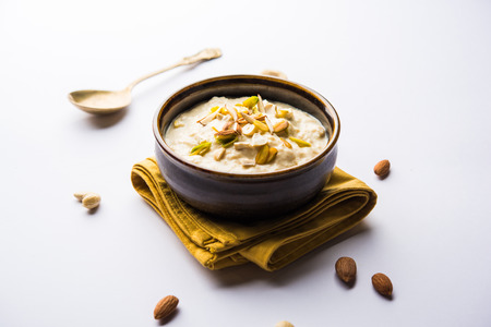Sweet Rabdi or Lachha Rabri or basundi, made with pure milk garnished with dry fruits. Served in a bowl over moody background. Selective focus 版權商用圖片