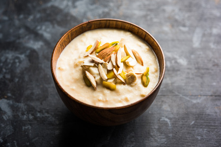 Sweet Rabdi or Lachha Rabri or basundi, made with pure milk garnished with dry fruits. Served in a bowl over moody background. Selective focus 写真素材