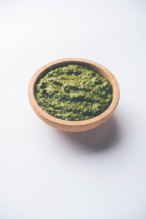 Healthy Indian Green Chutney or Sauce Made using Coriander, Mint And Spices. isolated over moody background. Selective focus