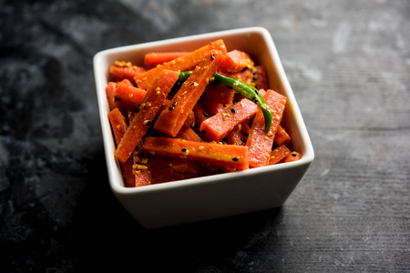 Carrot Pickle / Gajar ka Achar or Loncha in hindi. Served in a bowl over moody background. Selective focus 版權商用圖片
