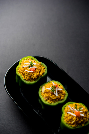 Stuffed capsicum or bharwa shimla mirchi is a popular Indian main course recipe. Stock Photo