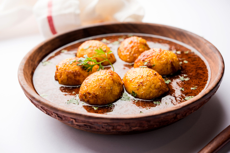 Fried egg curry or anda masala served in a bowl. selective focus Stock Photo