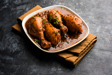 Chicken leg / drumstick curry or Murg Tangri/tangdi masala. Served in a bowl over moody background. Selective focus