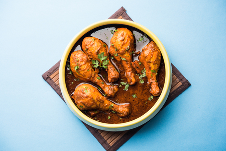 Chicken leg / drumstick curry or Murg Tangri/tangdi masala. Served in a bowl over moody background. Selective focus Reklamní fotografie
