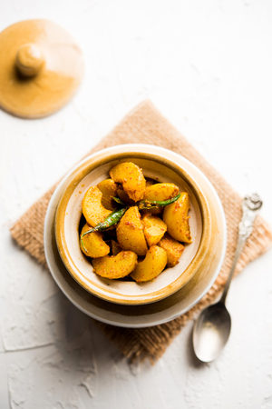 Homemade Gooseberry or amla Pickle/ or Aavle ka Achar in a bowl or barni over moody background.  selective focus Imagens