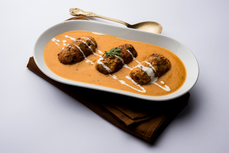 Malai Kofta Curry is a Mughlai special recipe served in a bowl. Selective focus Imagens