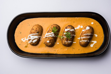 Malai Kofta Curry is a Mughlai special recipe served in a bowl. Selective focus Stock Photo