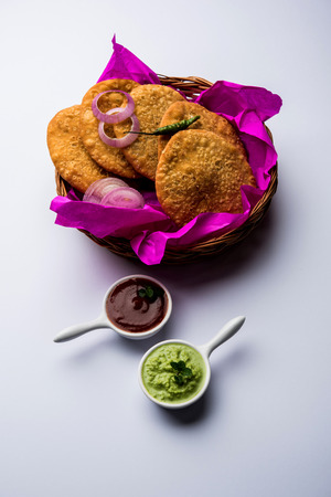 Shegaon or Rajasthani Kachori served with green Chutney and tomato ketchup Stock Photo