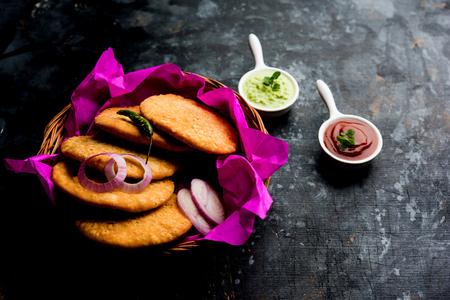 Shegaon or Rajasthani Kachori served with green Chutney and tomato ketchup Stock Photo
