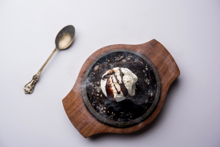 sizzling chocolate brownie is a sweet dish made using scoop of ice-cream on top served with a generous pouring of melted chocolate. server hot. selective focus Reklamní fotografie