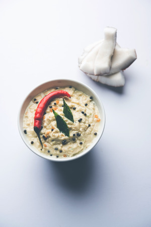 Nariyal or Coconut Chutney served in a bowl. Isolated over moody background. selective focus