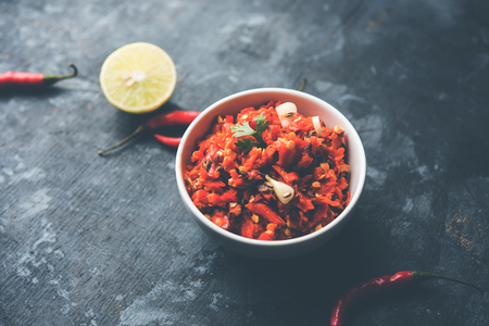 Hot and spicy Hot chilli chutney using lal mirch, cumin seeds, lemon juice and coriander. served in a bowl. selective focus
