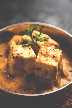 Malai or achari Paneer in a gravy made using Whipping Cream. served on a serving pan. selective focus Stock Photo