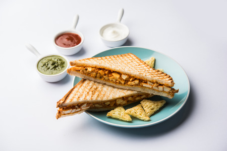Paneer tikka Sandwich - is a popular Indian version of sandwich using cottage cheese curry with tomato ketchup, mint chutney