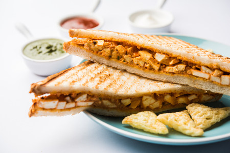 Paneer tikka Sandwich - is a popular Indian version of sandwich using cottage cheese curry with tomato ketchup, mint chutney Stok Fotoğraf - 113866817