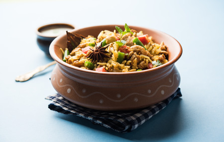 Kheema Pulao - Rice cooked with mutton or chicken mince with vegetables and spices. served in a bowl. selective focus Banco de Imagens