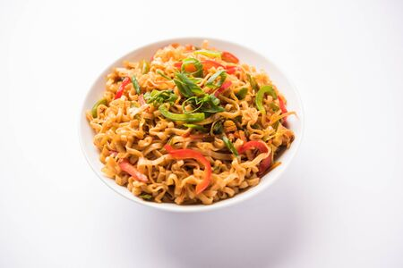 Schezwan veg noodles is a spicy and tasty stir fried flat Hakka noodles with sauce and veggies.