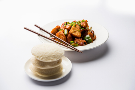 Schezwan Idli or manchurian Idly, tasty indo-chinese recipe. selective focus Stock Photo