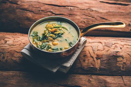 Dal Palak or Lentil spinach curry - popular Indian main course healthy recipe. served in a karahi/pan or bowl. selective focus