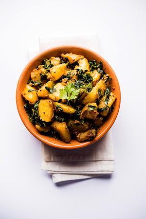 Fenugreek potato sabzi or Aloo Methi masala is healthy Indian Cuisine. served in a bowl or karahi. selective focus Banque d'images