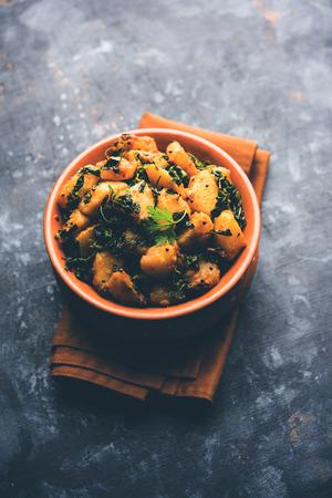 Fenugreek potato sabzi or Aloo Methi masala is healthy Indian Cuisine. served in a bowl or karahi. selective focus