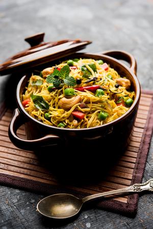 Spicy semiya uppma or upma served in plate. selective focus