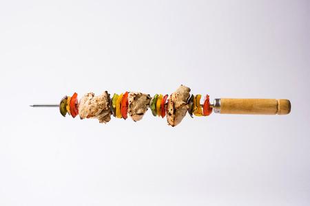 Chicken Hariyali kakab or Malai malai kebab served with skewers and yogurt dip in a plate. selective focus